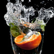 Stock Photo: Fruit drop with big splash