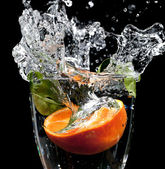 Fruit drop with big splash — Stock Photo