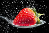 Strawberry sprinkled with sugar close up — Stock Photo