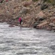 Fishermen fishing in mountain river - ストック写真
