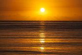 Wschód słońca nad horyzont morze — Zdjęcie stockowe