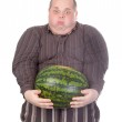 Fat man struggling to hold the weight of a whole watermelon — Stock Photo #13843618