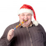 Cheerful fat man in Santa hat — Stock Photo #13843631