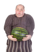 Fat man struggling to hold the weight of a whole watermelon — Stock Photo