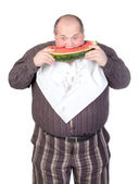 Obese man eating watermelon — Stock Photo
