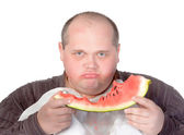Obese man possessive of his food — Stock Photo