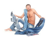 Indesicive man trying to dress — Stock Photo