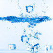 Ice Cubes Dropped into Water with Splash — Stock Photo