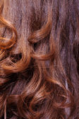 Background of wavy auburn hair — Stock Photo