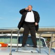 Fat man in tuxedo with glass wine — Stock Photo