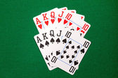 Poker cards with royal flush combination — Stock Photo