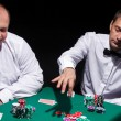 Stock Photo: Two gentlemen in white shirts, playing cards