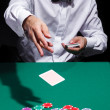 Gentleman in white shirt, playing cards — Stock Photo