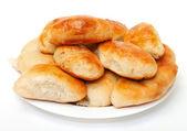 Heap baked patties on plate — Stock Photo