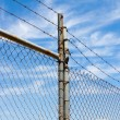 Mesh fence with barbed wire — ストック写真