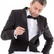 Man in a bow tie completing a form — Stock Photo #37148075