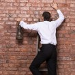 Stock Photo: Mup against brick wall