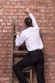 Man up against a brick wall — Stock Photo