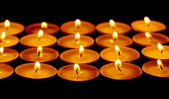 Tea lights candles with fire — Foto de Stock