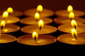 Tea lights candles with fire — Stok fotoğraf