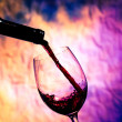 Red Wine Poured into Wineglass — Stock Photo #42752221