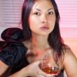 Woman with glass of cognac — Stock Photo