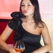Woman with glass of peach-brandy — Stock Photo