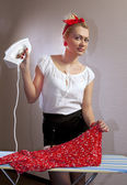Housewife irons the blouse — Stock Photo