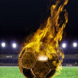 Fiery soccer ball on field — Stock Photo