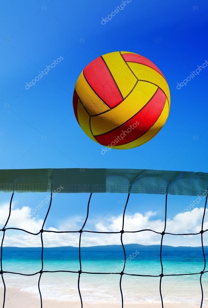Volleyball ball over grid on beach at sunny day  Stock Photo #12613699