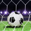 Soccer ball on stadium — Stock Photo
