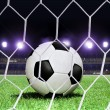 Soccer ball on stadium - Stock Photo