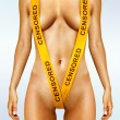 Body with yellow censorship tapes — Stock Photo #13185706