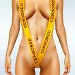 Body with yellow censorship tapes - Stock Photo