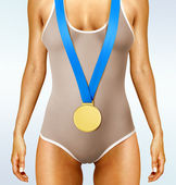 Body with gold medal — Stock Photo