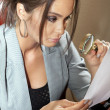 Woman looks on one document - Stock Photo