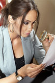 Woman looks on one document — Stock Photo
