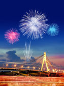 Firework over city at night — Stock Photo