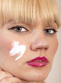 Cream on face — Stock Photo