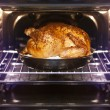 Turkey is baked in oven - Stock Photo