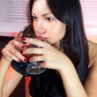 Woman with glass of brandy ll - Stock Photo