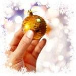 Christmas-tree decoration on hand — Stock Photo