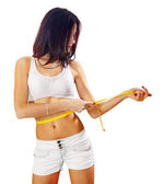 Caucasian woman measures her waist — Stock Photo