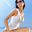 Beautiful woman in white swimming suit — Stock Photo #28593059