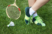 Foot of woman who plays badminton — Stock Photo
