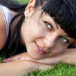Woman lies on grass — Stock Photo