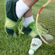 Foot of sportswoman on grass — Stock Photo