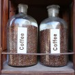 Coffee grains in glass vessels — Stock Photo #33995335