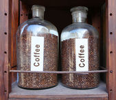 Coffee grains in glass vessels — Stock Photo