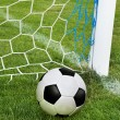 Soccer ball in goal net — Stockfoto